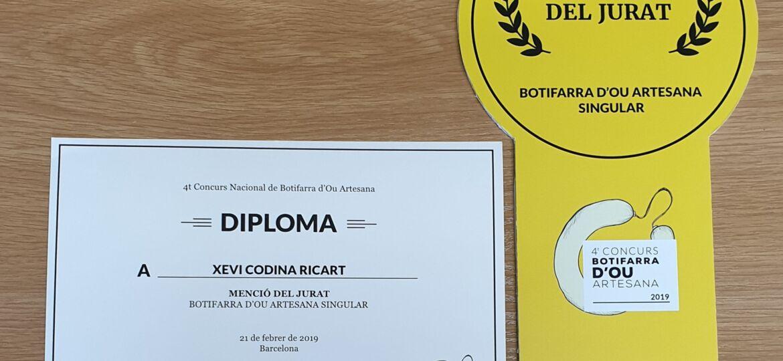 Medalla-i-diploma-menció-botif-ou